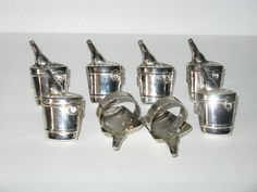 ANTIQUE SET OF 8 SILVERPLATE NAPKIN RINGS ~ CHAMPAGNE ICE BUCKETS