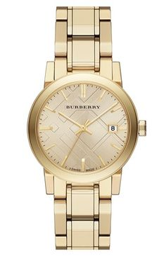 Shiny! Love this gold Burberry check stamped round bracelet watch.