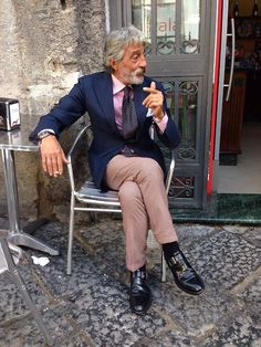 An everyday Neapolitan, an artisan in the handmade terracotta nativity figures typical of Naples, having just drunk his morning espresso outside a coffee shop in Via Tribunali corner with Piazza San Gaetano-Naples