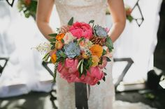 Bold peony bouquet of coral charm, protea, and peach garden roses. Flowers by KP Event Design in Kansas City - Kansas City Florist