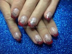 Acrylic nails with red tips with silver glitter dust