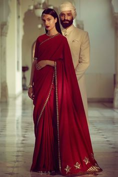 This red maroon saree from Panache Haute Couture is inspired by Sabyasachi and in matka silk with contrast motifs. The blouse is also in matka silk with embroidered neckline and petticoat is in satin fabric. Indian Wedding Outfits, Indian Outfits, Indian Dresses, Red Saree Wedding, Green Wedding, Indian Attire, Indian Wear, Sabyasachi Sarees Price, Sabhyasachi Sarees