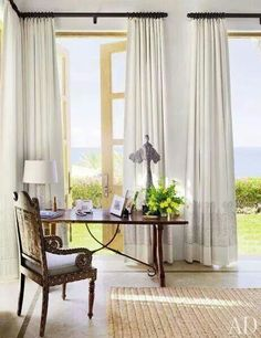 Love the neutral curtains with dark hardware to complement the furniture.
