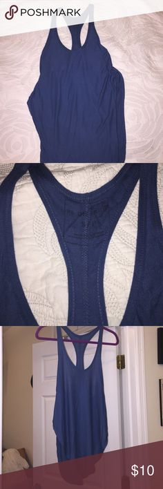 Free People Racer-back Tank We the Free- Free People Racer-back tank with side slits. Great with fun lacy bra. Size S. Free People Tops Tank Tops