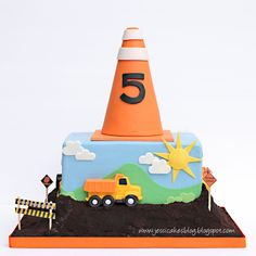 Construction Cake - I made this cake for my sons 5th b-day over this past weekend. The bulldozer, dump truck, digger and roller were done with chocolate molds. The cone was RKT and the cake was mudcake and vanilla cake covered in oreo cookie crumbs. Thanks for looking!