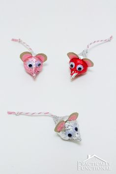 Valentine's Day Hershey's Kisses Mice: These adorable handmade Valentine's Day crafts only take five minutes to put together, and all you need are Hershey's Kisses, paper, string, googly eyes, and non-toxic glue!