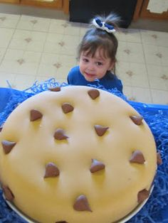 This is the exact cake I was picturing, made to look like a cookie! Those must be Hershey kisses as chocolate chips. :)