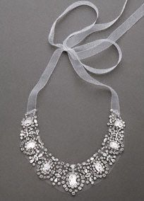 Never give up the illusion in this stunning crystal necklace!  Necklace features beautiful, large crystals that float on barely-there tulle.  Organza ribbon ties keep this necklace delicate and whimsical, a perfect fit to top of your outfit for your next special event!  Available in: Silver.  Imported.