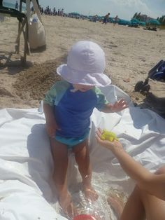 Bring shower curtain to beach to make pool for little one!! SO SMART!