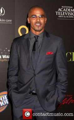 I'm not sure what's hotter, Shemar in a suit or shirtless...?!