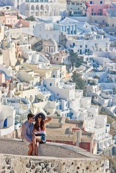 A couple admiring the view in Fira, Santorini, Greece