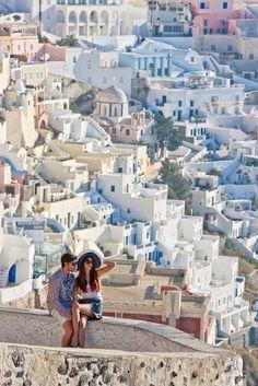 A couple admiring the view in Fira, Santorini, Greece