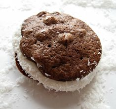 Passover Chocolate Coconut Whoopie Pies- ultra-chocolaty, chewy chocolate chip cookies sandwiched with marshmallow filling and dipped in shredded coconut. They happen to be kosher for Passover and gluten free. But no one would ever know. They are THAT good!| The Monday Box