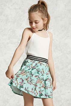 Forever 21 Girls - A woven floral mini skirt featuring a metallic stripe elasticized waist, cherry blossom print, and knife pleats.