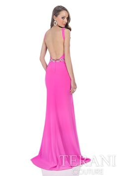 Halter crepe trumpet prom gown with wrap detail at the bodice, and cutout at the midsection. Prom dress is finished with sequin detail at the waistline.