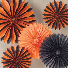 Festive paper rosettes for Halloween.  Adding a splash of spooky color couldn't be easier with this kit.