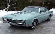 This was my other car I had in high school.....69 Buick Riviera...loved that car - mine was brown.