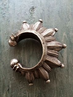 """""""According to many legends, the inhabitants of the Swat Valley, on the frontier of Afghanistan and Pakistan, are actually descendants of soldiers in the army of Alexander III of Macedon, more commonly known as Alexander the Great. This very old star-pointed silver cuff comes from that remote region of the world."""""""