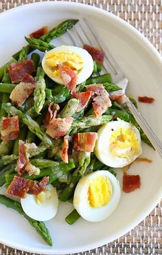 I love the combination of this simple salad of asparagus, hard boiled egg and bacon tossed with a Dijon vinaigrette – it has Spring written all over it!  I'm sharing this from the archives because asparagus is in season right now, and this is one of my go-to salads this time of year. Asparagus and eggs are a match made in heaven, but not just for breakfast, it's great for lunch too! I always keep hard boiled eggs on hand in my fridge to use throughout the week, therefore this salad came