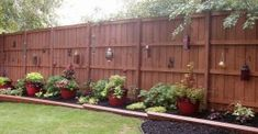 Hot Backyard Design Ideas to Try Now Tags: small backyard landscaping ideas, small backyard patio ideas, backyard ideas for kids, backyard ideas on a budget Privacy Fence Landscaping, Privacy Fence Designs, Backyard Privacy, Backyard Fences, Backyard Projects, Outdoor Landscaping, Landscaping Ideas, Privacy Fences, Desert Backyard