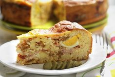 Pizza Rustica - an Italian Easter Pie full of cooked ham, salami, ricotta cheese and hard boiled eggs. A must for every Easter celebrating table!