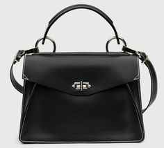 As much as we love seasonal colors and prints, it's hard to deny the everlasting allure of the black handbag. Unless you're a lady of leisure (lucky!) or the kind of person who's meticulous about changing her handbag to match her outfit every morning, you probably have a workhorse bag in your collection, and that …