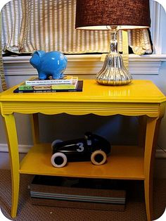 update an old table with bright yellow paint -- perfect for a nursery or to add color anywhere you want!