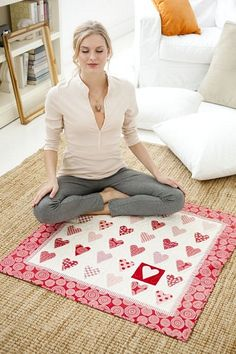 heart quilt...love how they pop a heart out by adding a red square!