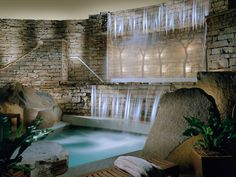 """This Poconos spa resort about 100 miles from New York City and Philadelphia sits on 150 woodland acres and comprises three gardens, a library with a lake-view porch, a soaking pool, three fitness studios, and a fireplace-warmed """"whisper lounge."""" Our favorite treatment: the muds-and-suds massage capped off by a Dogfish Head cider."""
