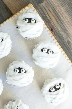 These little mummy cupcakes look like they took tons of time and effort to achieve, but blogger Eden swears they're a great last-minute option for Halloween party-hosting procrastinators. All you need to make the mummies' wraps is a flat frosting tip! Click through for the recipe more cute Halloween cupcakes.