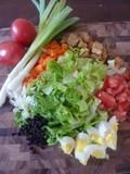 I recently saw Jamie Oliver pile all of his salad ingredients on a cutting board, then drizzle the dressing over the top and let the kids mix it with their (clean) hands. You can serve it directly off the board with tongs in the middle of the table. What a fun way to eat salad! Skip the raw eggs in the dressing though!
