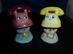 Almost as odd as the fishheads, a little less than the typewriters with paper faces. Vintage PY Anthropomorphic Telephone Head Girls Salt & Pepper Shaker Set
