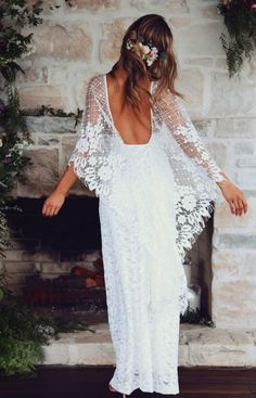 Lace dress with open back and dramatic cape sleeves. Grace Loves Lace