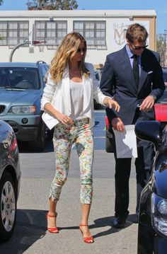 Gisele Bundchen wearing floral print Zara pants, a white blazer, and Dolce & Gabbana heels // #Spring #Style