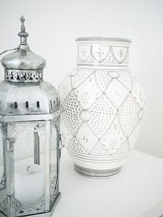 Vintage Moroccan decor elements. A hand painted vase and an antique iron lantern. #vintage #moroccan #decor # white // July
