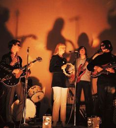 Nico playing her tamburine with the Velvet Underground .