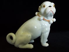 Antique Pug Dog Figurine with Bell Collar     S413 by shanasattic on Etsy https://www.etsy.com/listing/193614434/antique-pug-dog-figurine-with-bell