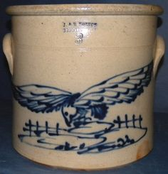 An uncommon three gallon crock with a hawk hovering over two fences. It was made at the J. & E. Norton pottery of Bennington, VT and dates from 1850 to 1859. This is the same piece that's featured on page 92 of the Birds of Bennington by Leder and Cesana. It has some very minor hairlines.    MRA-04825$13,500