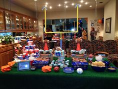 Sports baby shower - we had sports food- nachos, hot dogs, frito pie, cracker hacks and peanuts as the party favors, used serving boats instead of plates and bowls, cupcakes and a chocolate fountain.