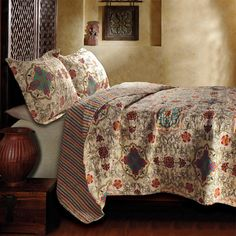 Add a pop of pattern to your master suite or guest room with this lovely reversible cotton quilt set, showcasing a medallion motif for stylish appeal.