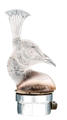 A rare frosted glass car mascot, tete de Paon, by R. Lalique, French, circa 1920, moulded mark R Lalique, chrome plated base.