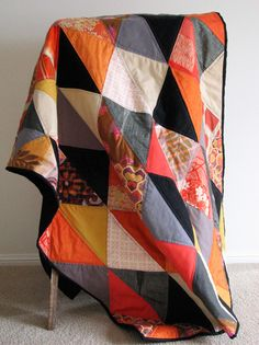 Kimono quilt by Tiel. Love the graphic sharpness and the contrasting colours.