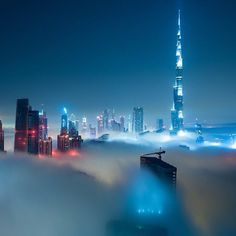 Dubai Skyline at night with clouds- could you imagine being on the top floor in anyy of these buildings?? Shiiiiiiit