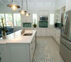 Ocean wave rug runner in coastal home's kitchen... http://www.completely-coastal.com/2017/01/beach-style-with-muted-blue-sea-green.html