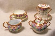 Thomas Sevres Bavaria Violet Motif Creamer & Sugar Bowl hand painted and signed by Pickard Studios artist Albert Wagner c.1905-1910 from our collection.