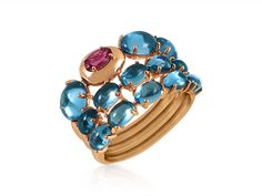 Brumani Corcovado Three-Row Band, Fashioned in 18K Rose Gold, Featuring One Oval Rhodolite Garnet =.28cts Total Weight and Thirteen Oval Londonz Blue Topaz =7.02cts Total Weight