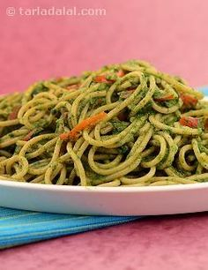 Spaghetti tossed in a spinach and cheese sauce with colourful vegetables makes a delightful recipe.  The beautiful green colour and good coating quality of the sauce makes it useful when serving along with pasta for a lunch or dinner.  The cheese spread blends beautifully to give a thick and creamy sauce.  To retain the fresh green colour of spinach, blanch the spinach and refresh quickly in ice-cold water. You may add a pinch of soda bi-carb to the water in which spinach is to be boiled…