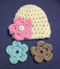 Babies hat with interchangeable flowers