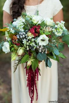 Awesome organic bouquet!  Blue spruce, eucalyptus, blushing bride, hanging amaranthus, anemones, silver brunia, Queen Anne's lace.