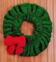 Crocheted Christmas Wreath: This pretty crocheted wreath can be finished in a snap--just in time for holiday decorating. countrywomanmagazine.com